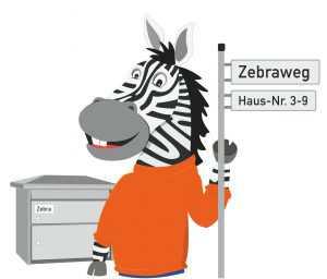 Zebra mit Straßenschild und Briefkasten